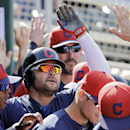 Cleveland Indians' Nick Swisher celebrates in the dugout after a solo home run against the Milwaukee Brewers in the sixth inning of a spring exhibition baseball game Wednesday, March 26, 2014, in Goodyear, Ariz The Associated Press