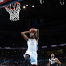 Kevin Durant #35 of the Oklahoma City Thunder dunks against the San Antonio Spurs on November 27, 2013 at the Chesapeake Energy Arena in Oklahoma City, Oklahoma. (Photo by Layne Murdoch/NBAE via Getty Images)