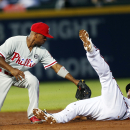 Dodgers get Kendrick, work to add Rollins The Associated Press