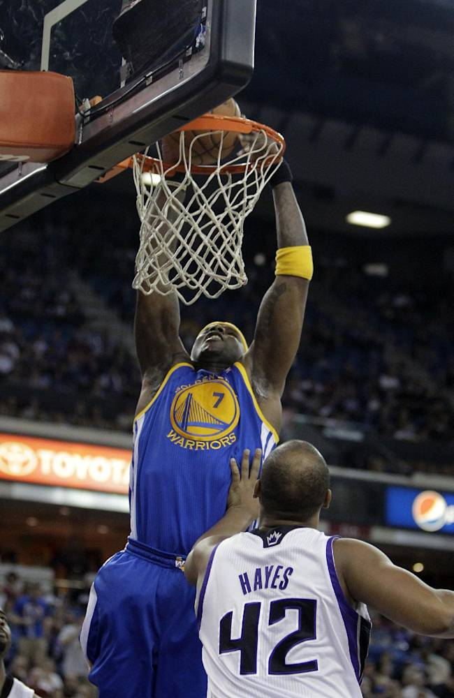Golden State Warriors center Jermaine O'Neal, left, goes for a shot over Sacramento Kings forward Chuck Hayes during the first quarter of an NBA basketball game in Sacramento, Calif., Sunday, Dec. 1, 2013