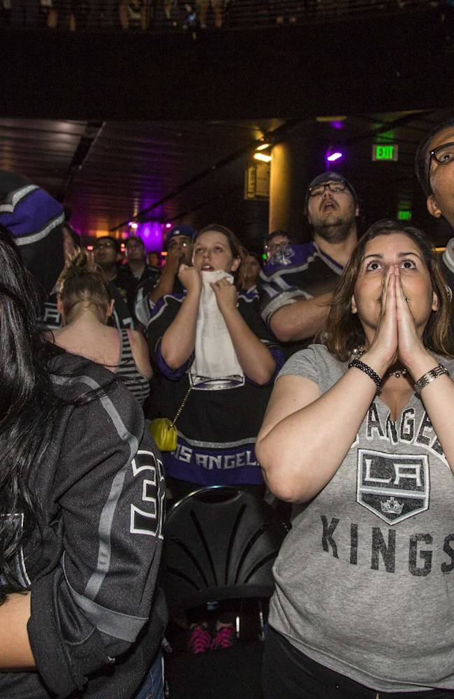Los Angeles Kings fans react at Club Nokia at L.A. LIVE as they watch Game 4 of the NHL hockey Stanley Cup Finals against the New York Rangers, Wednesday, June 11, 2014. The Rangers defeated the Kings 2-1