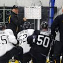 Boston Bruins head coach Claude Julien instructs his players during hockey training camp in Wilmington, Mass., Friday, Sept. 19, 2014. (AP Photo/Elise Amendola)