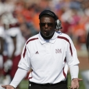FILE - In this Nov. 3, 2012, file photo, New Mexico State coach DeWayne Walker reacts on the sidelines during the second half of a 42-7 loss to Auburn in an NCAA college football game at Jordan-Hare Stadium in Auburn, Ala. Walker has stepped down after four losing seasons to take a job as an assistant with the Jacksonville Jaguars. Athletics director McKinley Boston announced Thursday, Jan. 24, 2013, that Walker is leaving to become defensive backs coach for the NFL team. (AP Photo/Dave Martin, File)
