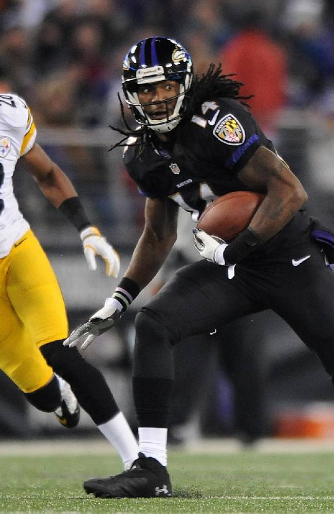 Baltimore Ravens wide receiver Marlon Brown (14) rushes the ball past Pittsburgh Steelers cornerback Cortez Allen in the second half of an NFL football game on Thursday, Nov. 28, 2013, in Baltimore