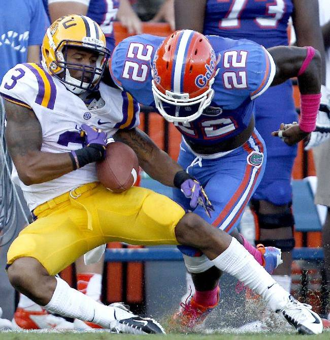 In this Oct. 6, 2012, file photo, Florida safety Matt Elam, right, forces LSU wide receiver Odell Beckham Jr. to fumble the ball after a long reception during the third quarter of an NCAA college football game at Ben Hill Griffin Stadium on Saturday, Oct. 6, 2012 in Gainesville, Fla. Beckham is coming off one of the best games of his career in a victory at Mississippi State last weekend. The thing is, about this time last year, he had one of the more frustrating days of his career in Gainesville. LSU host the Florida on Saturday