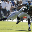 Carolina Panthers wide receiver Kelvin Benjamin (13) moves as Seattle Seahawks strong safety Kam Chancellor (31) tackles during the first half of an NFL football game, Sunday, Oct. 26, 2014, in Charlotte The Associated Press