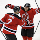 New Jersey Devils' Stephen Gionta, right, celebrates his goal with Mark Fayne during the third period of an NHL hockey game against the Detroit Red Wings Tuesday, March 4, 2014, in Newark, N.J. The Devils won 4-3 The Associated Press