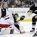 Pittsburgh Penguins' Evgeni Malkin (71) fires a shot past Columbus Blue Jackets goalie Curtis McElhinney (31) for a goal in the second period of an NHL hockey game in Pittsburgh, Monday, Dec. 9, 2013 The Associated Press