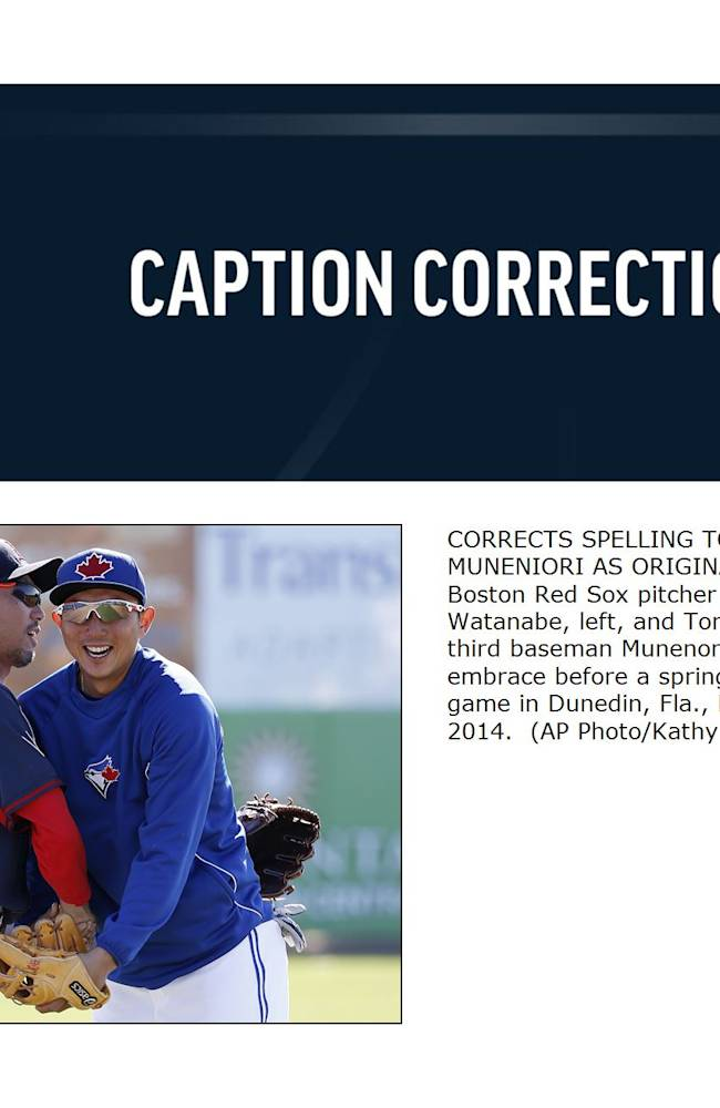 CORRECTS SPELLING TO MUNENORI, NOT MUNENIORI AS ORIGINALLY SENT -  Boston Red Sox pitcher Shunsuke Watanabe, left, and Toronto Blue Jays third baseman Munenori Kawasaki embrace before a spring training baseball game in Dunedin, Fla., Friday, March 14, 2014