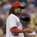 Cueto keeping an eye his mechanics photo