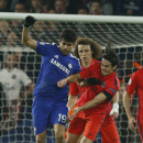 Chelsea's Diego Costa, left, challenges for the ball with PSG's Edinson Cavani, right, while PSG's David Luiz looks on during their Champions League round of 16 second leg soccer match between Chelsea and Paris Saint Germain at Stamford Bridge stadium in