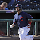 Cleveland Indians' Mike Aviles jogs home after a solo home run off Colorado Rockies deliver Adam Ottavino in the sixth inning of a spring exhibition baseball game, Saturday, March 22, 2014, in Goodyear, Ariz The Associated Press