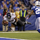 Baltimore Ravens running back Justin Forsett dives into the end zone for a touchdown in front of Indianapolis Colts strong safety Mike Adams during the second half of an NFL football game in Indianapolis, Sunday, Oct. 5, 2014 The Associated Press