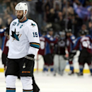 San Jose Sharks center Joe Thornton heads off ice as members of the Colorado Avalanche celebrate in the background after the Avalanche's 3-2 victory in an NHL hockey game in Denver on Saturday, March 29, 2014 The Associated Press