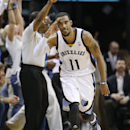 In this April 9, 2014 file photo, Memphis Grizzlies guard Mike Conley celebrates after scoring against the Miami Heat in the second half of an NBA basketball game in Memphis, Tenn. Conley has won the NBA's Joe Dumars Trophy for sportsmanship, Thursday, Ap