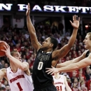 Purdue's Terone Johnson (0) and Sandi Marcius, right, block out Wisconsin's Ben Brust during the second half of an NCAA college basketball game, Sunday, March 3, 2013, in Madison, Wis. Purdue won 69-56. (AP Photo/Andy Manis)