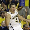 Michigan forward Mitch McGary (4) celebrate after a play during the second half of an NCAA college basketball game against Northwestern in Ann Arbor, Mich., Wednesday, Jan. 30, 2013. (AP Photo/Carlos Osorio)