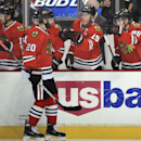 Caps score 3 goals late in 2nd to beat Blackhawks The Associated Press