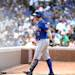New York Mets' David Wright walks back to dugout after fouling out in the eighth inning as the Chicago Cubs beat the Mets 8-2 in a baseball game in Chicago on Saturday, May 18, 2013