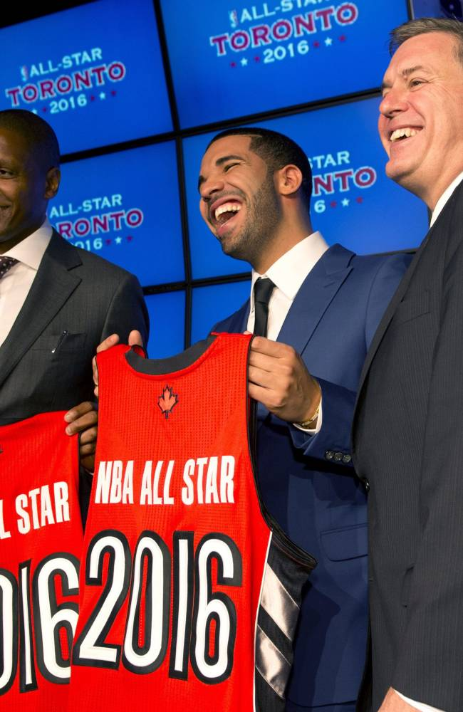 Toronto Raptors general manager Masai Uriji, left, Canadian recording artist Drake, center, and Maple Leaf Sports and Entertainment President and CEO Tim Leiweke pose with jerseys after the announcement that the Raptors will host the 2016 NBA All Star game at a news conference in Toronto on Monday Sept. 30, 2013