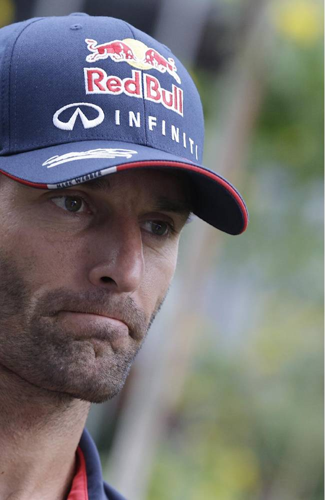 Red Bull driver Mark Webber of Australia is interviewed outside his team garage ahead of the Indian Formula One Grand Prix at the Buddh International Circuit in Noida, India, Thursday, Oct. 24, 2013