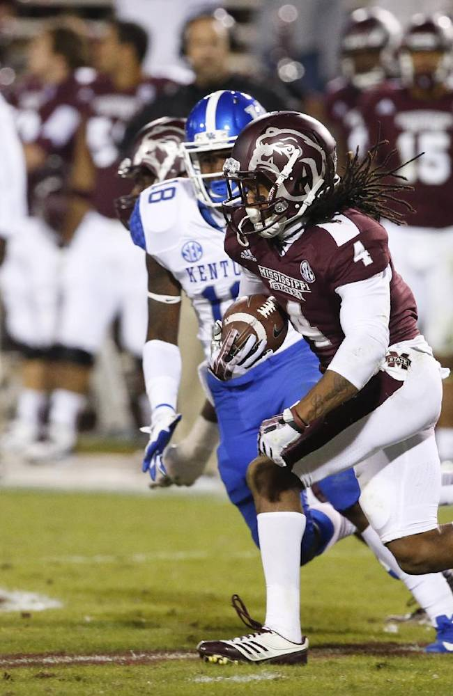 Mississippi State wide receiver Jameon Lewis (4) runs through a group of Kentucky defenders in the second half of their NCAA college football game at Davis Wade Stadium in Starkville, Miss., Thursday, Oct. 24, 2013. Mississippi State won 28-22