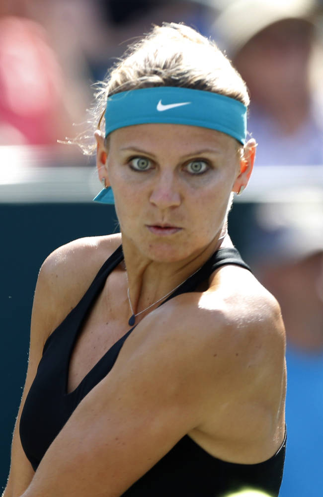 Lucie Safarova, of the Czech Republic, watches the ball before hitting a return to Andrea Petkovic, of Germany, during the Family Circle Cup tennis tournament in Charleston, S.C., Friday, April 4, 2014
