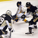 Nashville Predators' Gabriel Bourque, center, falls in front of Pittsburgh Penguins goalie Marc-Andre Fleury (29) as defenseman Kris Letang (58) looks for the puck during the first period of an NHL hockey game in Pittsburgh on Friday, Nov. 15, 2013 The As
