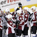 The Colorado Avalanche celebrates around goalie Semyon Varlamov (1) his 2-0 shutout of the Chicago Blackhawks after an NHL hockey game Tuesday, Jan. 6, 2015, in Chicago The Associated Press