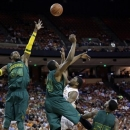 Texas' Julien Lewis, second from right, is pressured by Baylor's Cory Jefferson (34), Deuce Bello (14) and Pierre Jackson (55) during the first half of an NCAA college basketball game, Monday, March 4, 2013, in Austin, Texas. (AP Photo/Eric Gay)