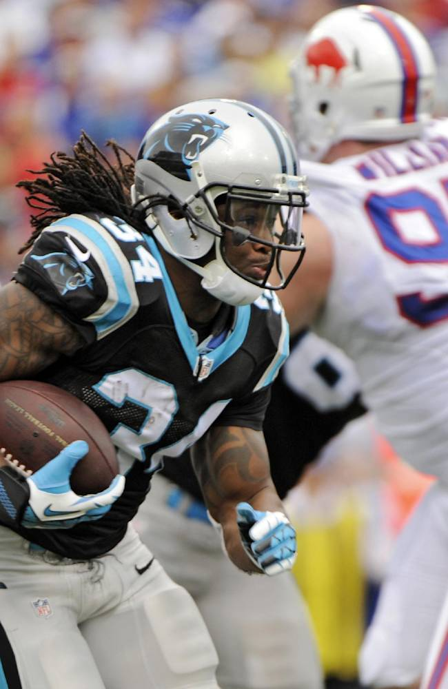 Carolina Panthers running back DeAngelo Williams runs the ball against the Buffalo Bills in the second quarter of an NFL football game Sunday, Sept. 15, 2013, in Orchard Park, N.Y