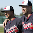 Atlanta Braves relief pitchers Anthony Varvaro, left, and Jordan Walden walk to the start of a spring training baseball workout on Sunday, Feb. 16, 2014, in Kissimmee, Fla The Associated Press