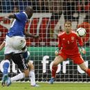 Italy's Mario Balotelli scores his side's second goal during the Euro 2012 soccer championship semifinal match between Germany and Italy in Warsaw, Poland, Thursday, June 28, 2012. (AP Photo/Frank Augstein)