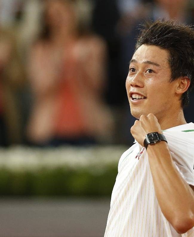 Kei Nishikori from Japan celebrates his victory during a Madrid Open tennis tournament match against David Ferrer from Spain in Madrid, Spain, Saturday, May 10, 2014