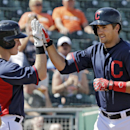 Cleveland Indians' Lonnie Chisenhall, right, is greeted by Luke Carlin after a solo home run off Milwaukee Brewers starting pitcher Yovani Gallardo in the second inning of a spring exhibition baseball game Wednesday, March 26, 2014, in Goodyear, Ariz The