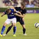 Leicester Ciry's Marc Albrighton, left, battles for the ball with Everton's Luke Garbutt during their friendly soccer match at Suphachalasai stadium in Bangkok, Thailand, Sunday July 27, 2014. Leicester City beat Everton 1-0
