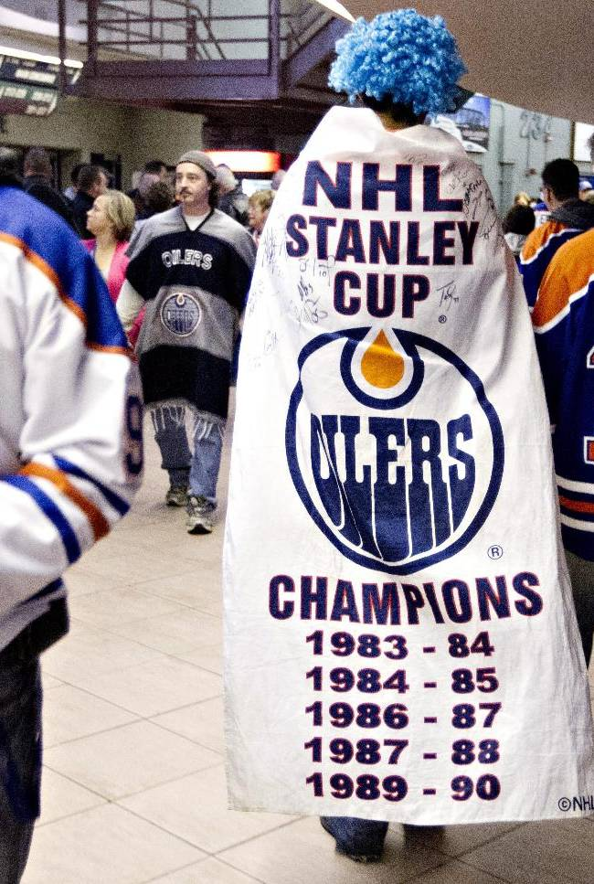 Edmonton Oilers fans make their way to their seats in Edmonton, Alberta, on Tuesday, Oct. 1, 2013, before the Oilers' NHL hockey game against the Winnipeg Jets