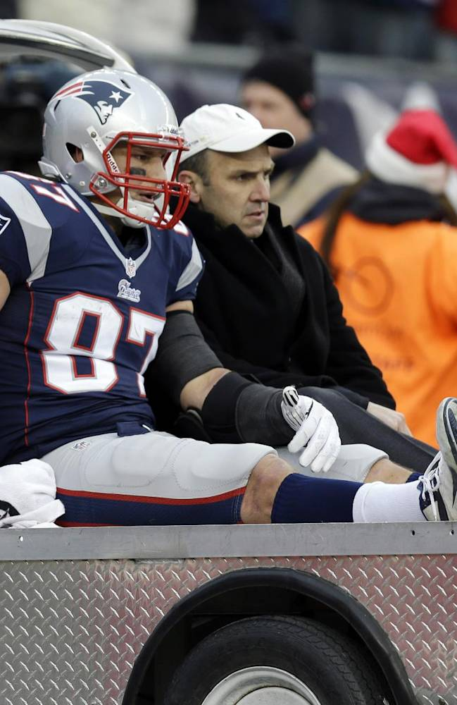 In this Sunday, Dec. 8, 2013, file photo, New England Patriots tight end Rob Gronkowski is carted off the field after getting injured in the third quarter of an NFL football game against the Cleveland Browns in Foxborough, Mass. Gronkowski's season ended abruptly Sunday with a knee injury when he took a low hit from Cleveland Browns safety T.J. Ward. No penalty was called