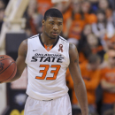 Oklahoma State guard Marcus Smart holds the ball during an NCAA basketball game in Stillwater, Okla., Saturday, Mar. 2, 2013. Oklahoma State defeated Texas 78-65. (AP Photo/Brody Schmidt)
