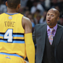 Denver Nuggets head coach Brian Shaw, right, makes a point to guard Randy Foye while facing the Utah Jazz in the fourth quarter of the Nuggets' 101-94 victory in an NBA basketball game in Denver on Saturday, April 12, 2014 The Associated Press