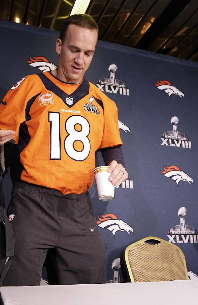 Denver Broncos quarterback Peyton Manning arrives for a news conference Wednesday, Jan. 29, 2014, in Jersey City, N.J. The Broncos are scheduled to play the Seattle Seahawks in the NFL Super Bowl XLVIII football game Sunday, Feb. 2, in East Rutherford, N.J