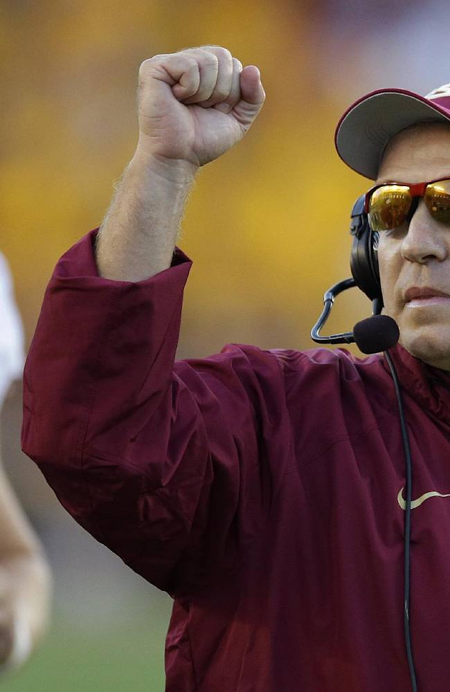 Florida State head coach Jimbo Fisher pumps his fist after his team scored a touchdown during the second half of an NCAA college football game against Boston College in Boston, Mass., Saturday, Sept. 28, 2013. Florida State defeated Boston College 48-34