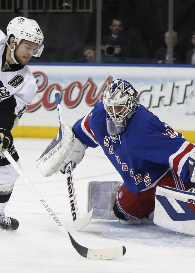 Pittsburgh Penguins left wing Chris Kunitz (14) maneuvers the puck in front of New York Rangers goalie Henrik Lundqvist (30) of Sweden in the first period of their second-round NHL Stanley Cup hockey playoff game at Madison Square Garden in New York, Monday, May 5, 2014