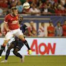 Manchester United's Luke Shaw plasys Paris Saint-Germain during International Champions Cup play in Chicago Wednesday, July 29, 2015. (AJ Mast / AP Images for International Champions Cup)