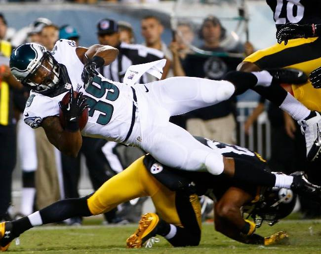 Philadelphia Eagles' Matthew Tucker (39) is tackled by Pittsburgh Steelers' Mike Mitchell (23) during the second half of an NFL preseason football game, Thursday, Aug. 21, 2014, in Philadelphia
