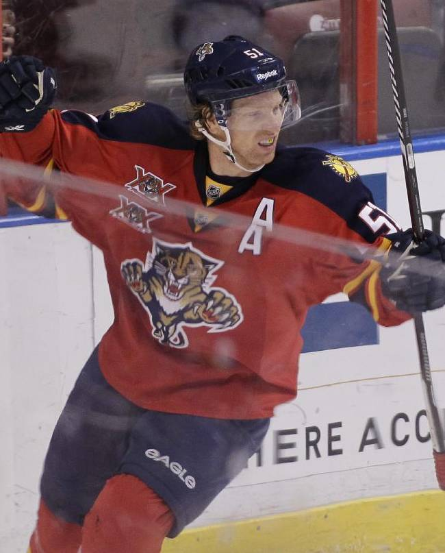 Florida Panthers' Brian Campbell reacts after scoring a goal during the first period of an NHL hockey game against the New Jersey Devils, Friday, March 14, 2014, in Sunrise, Fla