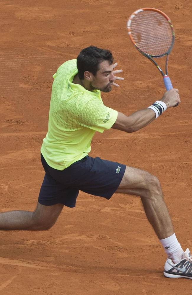 Jeremy Chardy returns the ball to David Ferrer of Spain during their match at the Monte Carlo Tennis Masters tournament in Monaco, Tuesday, April 15, 2014. Ferrer won 6-3 6-0