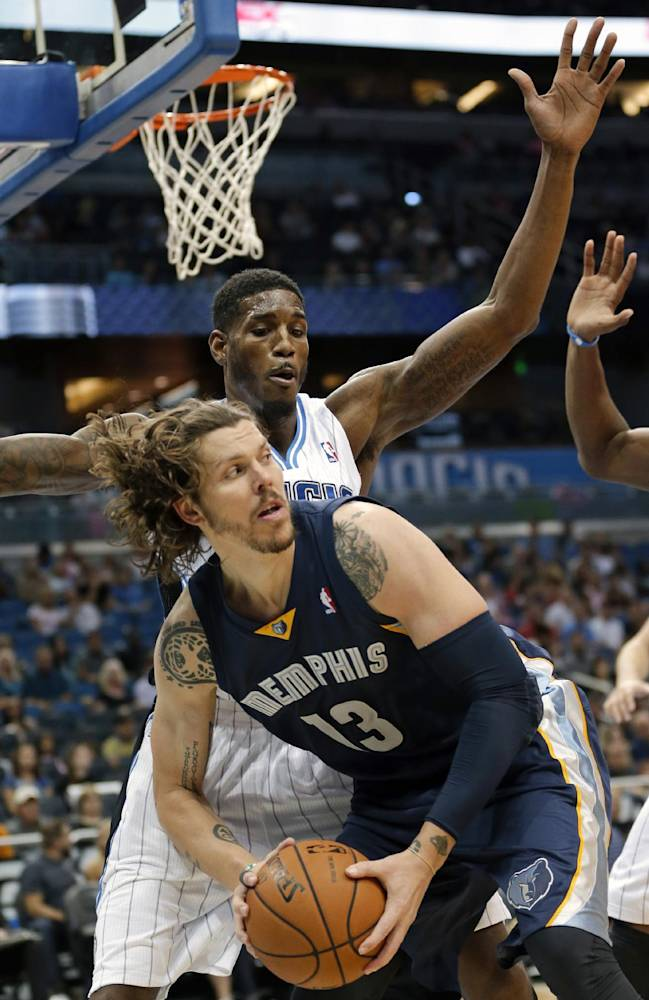 Memphis Grizzlies' Mike Miller (13) looks to pass the ball as he is guarded by Orlando Magic's Solomon Jones during the first half of an NBA preseason basketball game in Orlando, Fla., Friday, Oct. 18, 2013
