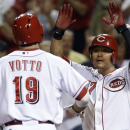 Cincinnati Reds' Joey Votto (19) is congratulated by Shin-Soo Choo (17) after Votto hit a two-run home run off Los Angeles Dodgers relief pitcher J.P. Howell in the fifth inning of a baseball game, Friday, Sept. 6, 2013, in Cincinnati. (AP Photo/Al Behrman)
