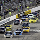 Brian Scott (2) leads the pack at the start of NASCAR's Nationwide auto race at Richmond International Raceway in Richmond, Va., Friday, Sept. 6, 2013. (AP Photo/Jason Hirschfeld)